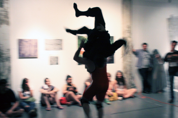 Performance Documentation (photograph) of 0H10M1KE and TJ in Brooklyn Fireproof Gallery, Brooklyn NY.